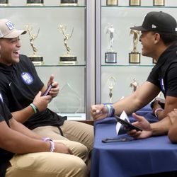 BYU running back Lopini Katoa, back left, laughs while chatting with teammates during BYU football media day at the BYU Broadcasting Building in Provo on Thursday, June 17, 2021.
