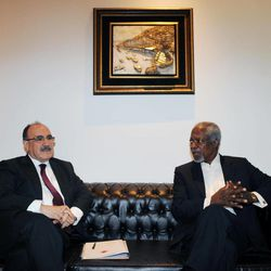U.N.-Arab League envoy Kofi Annan, right, speaks with Turkey's Deputy Prime Minister Besir Atalay after his visit to a Syrian refugee camp in Yayladagi, Turkey, April 10, 2012.