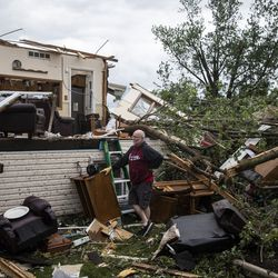 Mike Baar, 70, of Dixon, takes a break to look around while helping to clear out his sister-in-law's house on Janes Avenue near Evergreen Lane in Woodridge after a tornado ripped through the western suburbs overnight, Monday morning, June 21, 2021.
