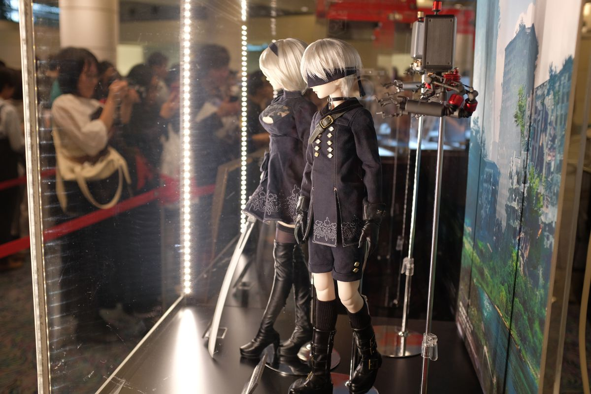 2B and 9S figures stand on display at the Nier concert