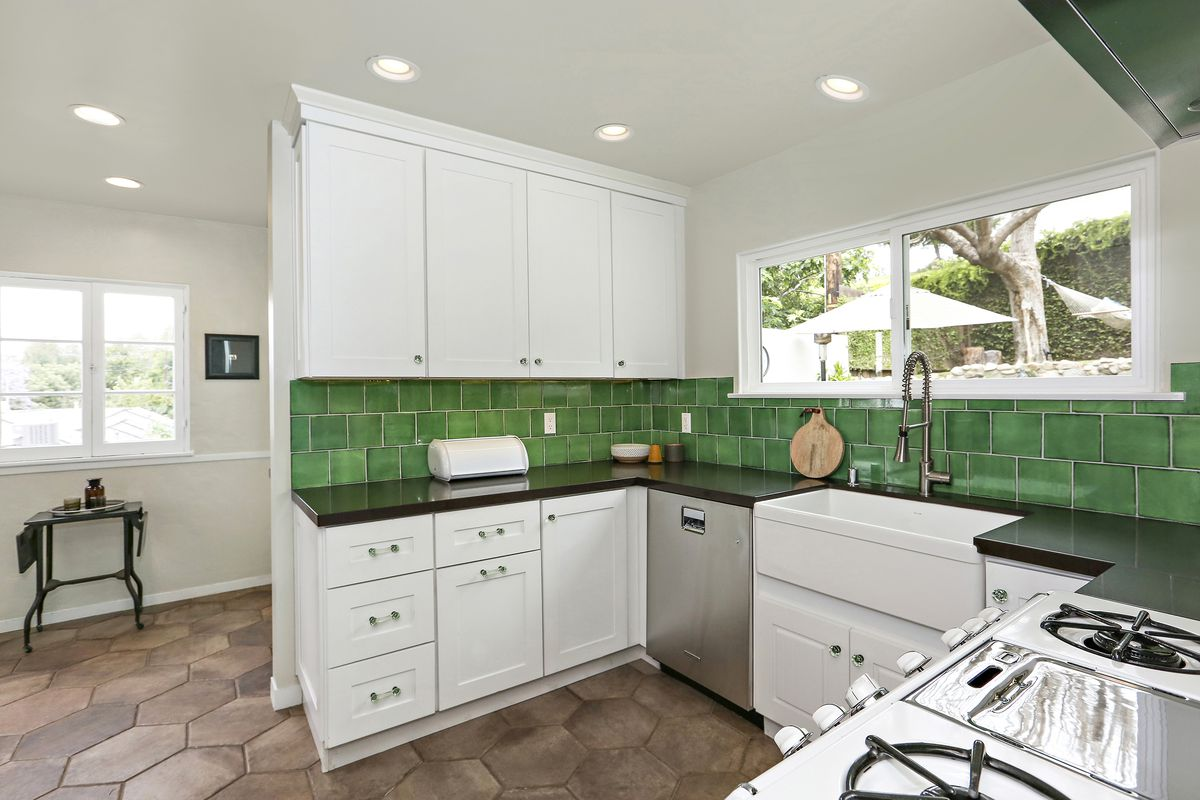 1931 Spanish-style house with emerald green kitchen asks $799K in ...
