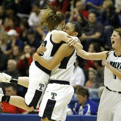 Timpanogos' Mercedes Riggs jumps into the arms of Eternity Galeai and  Briana Arnold shouts after Riggs made a long 3-poin-shot to end the first half as Timpanogos High School defeats Springville High School 62-47 to win the 4A Girl's Championship basketball game Saturday, Feb. 25, 2012, in Taylorsville, Utah.