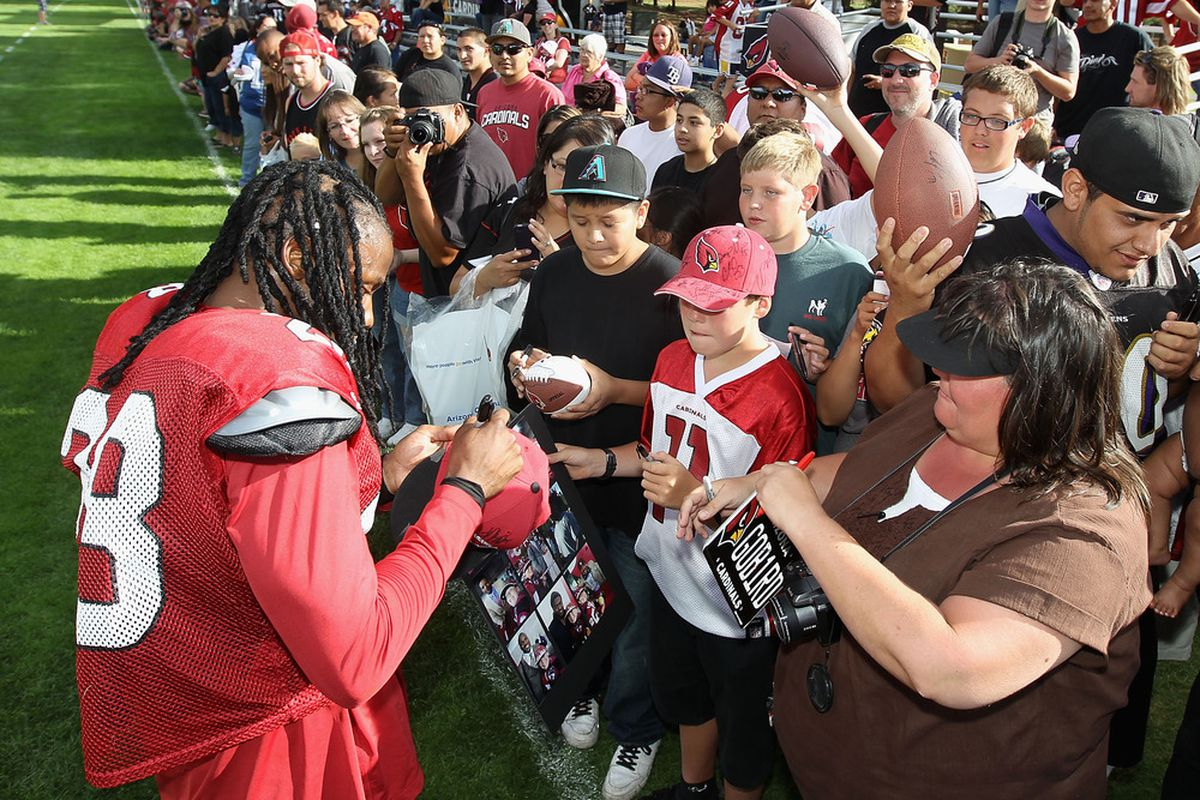 FLAGSTAFF, AZ - JULY 31:  Cornerback Greg Toler #28 of the Arizona Cardinals signs autographs for fans following the team training camp at Northern Arizona University on July 31, 2011 in Flagstaff, Arizona.  (Photo by Christian Petersen/Getty Images)