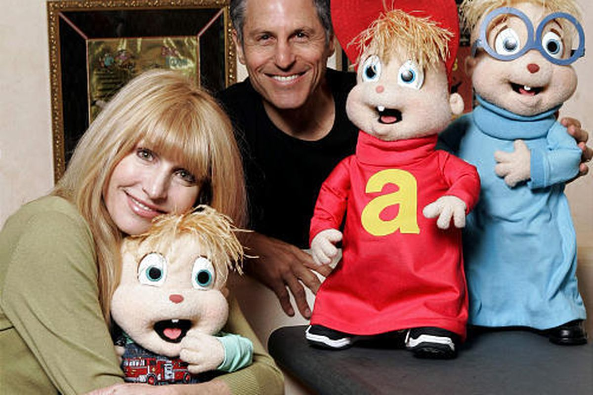 Ross Bagdasarian Jr. and his wife, Janice Karman, pose with stuffed versions of the Chipmunks, from left, Theodore, Alvin and Simon.