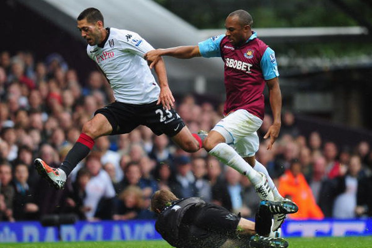 Clint Dempsey is one on one with Goalkeeper Robert Green of West Ham. Photo via Getty Images.