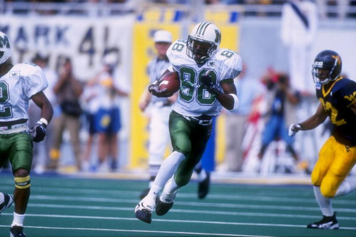 30 Aug 1997: Wide receiver Randy Moss #88 of the Marshall Thundering Herd carries to football during the Thundering Herd 42-31 loss to the West Virginia Moutaineers at Mountaineer Field in Morgantown, West Virginia. (Rick Stewart /Allsport)