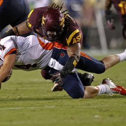Illinois quarterback Reilly O'Toole (4) is tackled by Arizona State defensive tackle Will Sutton (90) during the first half of an NCAA college football game, Saturday, Sept. 8, 2012, in Tempe, Ariz.