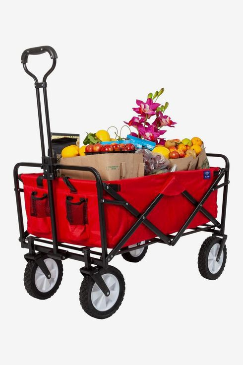 A collapsible folding outdoor utility wagon in red filled with grocery bags