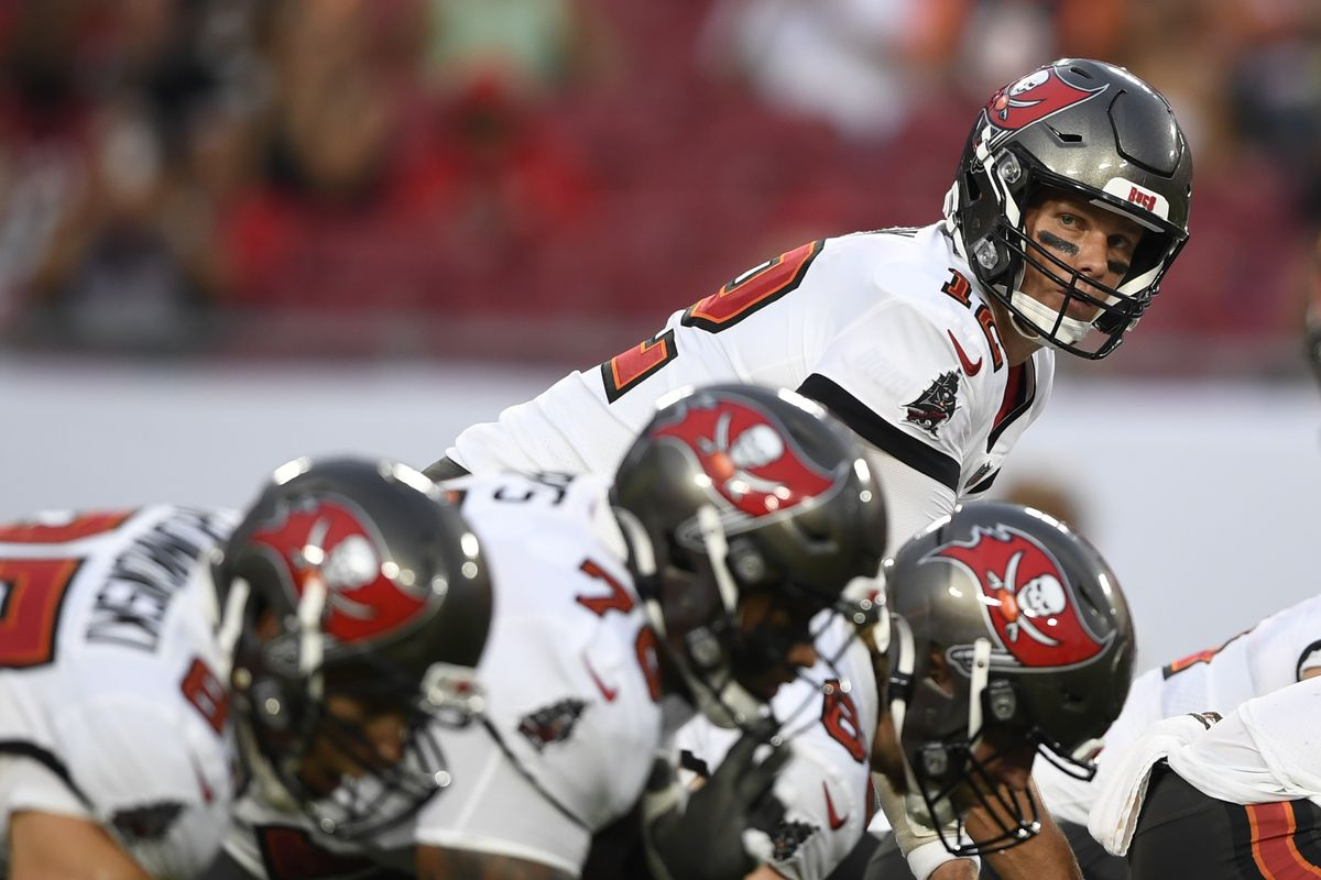 Tom Brady #12 of the Tampa Bay Buccaneers stands behind center during the first quarter against the Cincinnati Bengals during a preseason game at Raymond James Stadium on August 14, 2021 in Tampa, Florida.