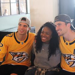 Kevin Fiala and Roman Josi pose with an excited fan at Pinewood Social in Nashville.