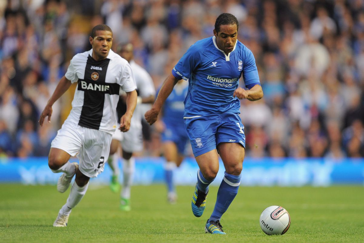 Jean Beausejour of Birmingham in action with Claudemir Silva of CD Nacional during the UEFA Europa League Play-Off match between Birmingham City FC and CD Nacional
