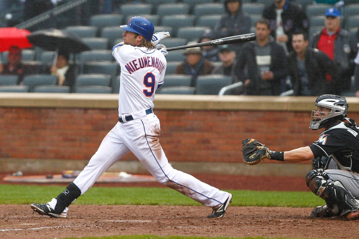 Apr. 26, 2012; Flushing, NY, USA; New York Mets center fielder Kirk Nieuwenhuis (9) hits a game-winning RBI single during the ninth inning against the Miami Marlins at Citi Field. Mets won 3-2. Mandatory Credit: Debby Wong-US PRESSWIRE