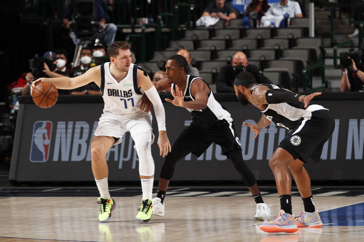 Rajon Rondo of the LA Clippers plays defense on Luka Doncic of the Dallas Mavericks during Round 1, Game 3 of the 2021 NBA Playoffs on May 30, 2021 at the American Airlines Center in Dallas, Texas.