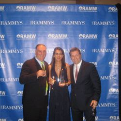 Cafe Atlantico/minibar employee Ryme Lansari won for best restaurant employee and poses with her employers.