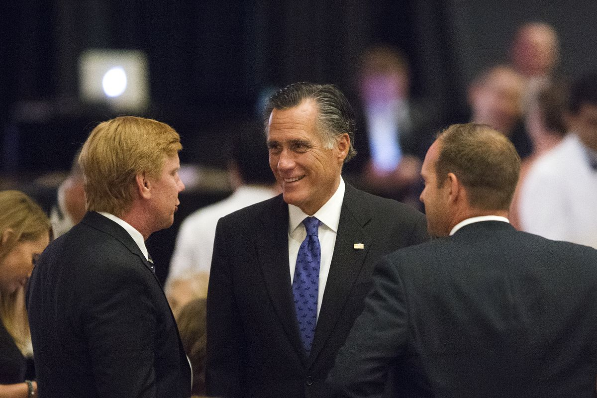 Mitt Romney, a Republican candidate for U.S. Senate, socializes before a ceremony recognizing Sen. Orrin Hatch, R-Utah, as the 39th Giant in Our City at the Grand America Hotel in Salt Lake City on Saturday, June 9, 2018. The Salt Lake Chamber, Utah's largest business association, gives the award to honor outstanding professional achievement and public service.