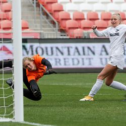 Ridgeline's Tenzi Knowles scores on Ogden goalkeeper Allison Collingwood to give Ridgeline a 2-1 lead in the 4A girls soccer state championship game at Rio Tinto Stadium in Sandy on Friday, Oct. 23, 2020.