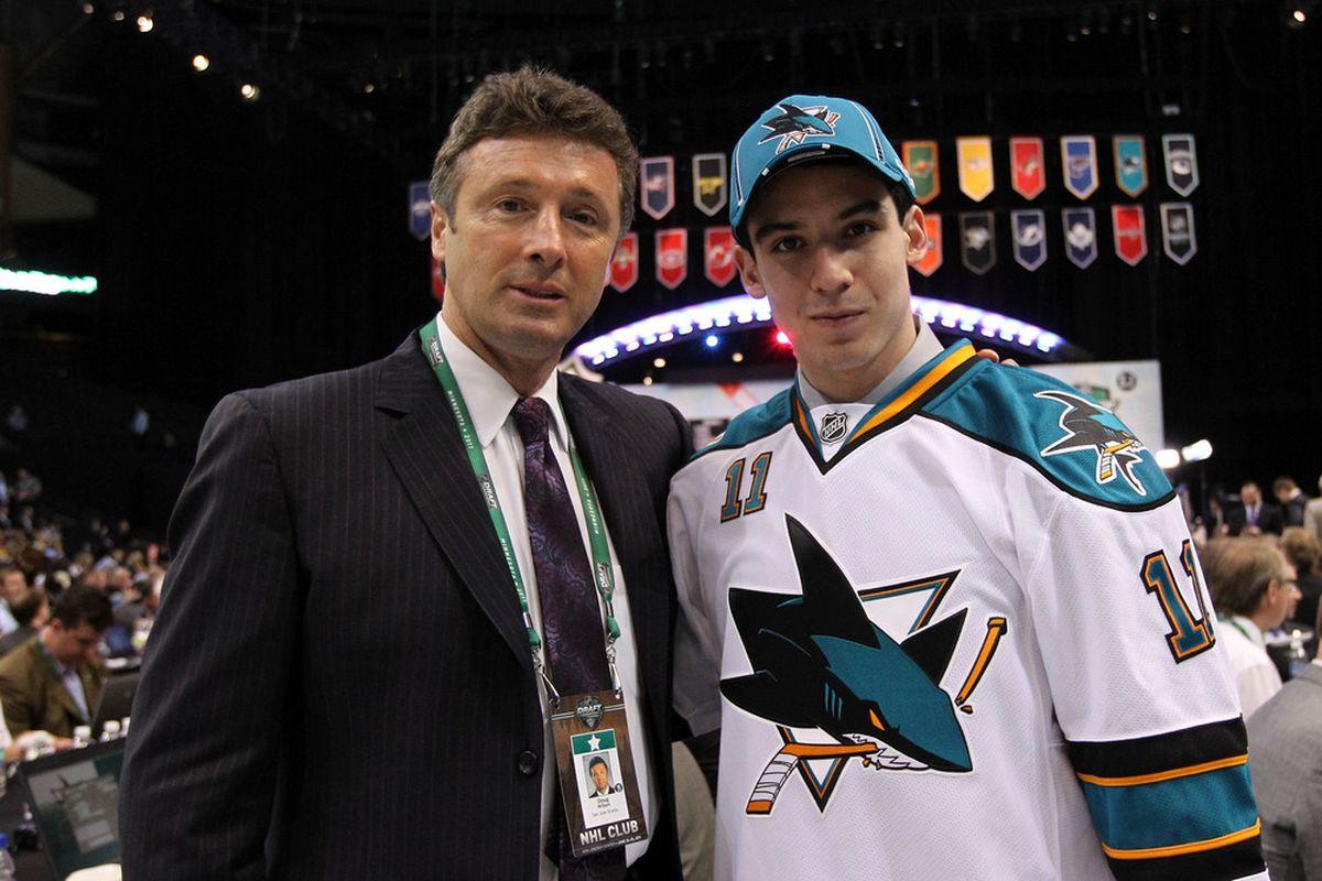 <em>Doug Wilson poses with second round pick Matt Nieto at the 2011 NHL Entry Draft in St. Paul, Minnesota.</em>