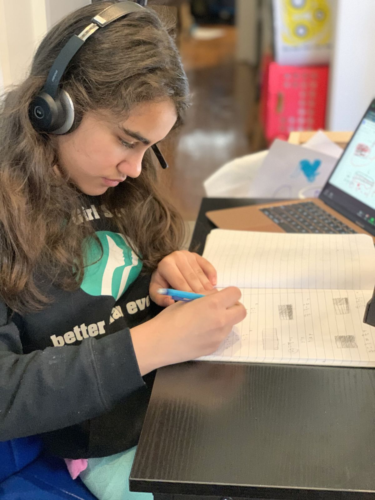 Inocencia Olivo's daughter Chloe works on an assignment from home.