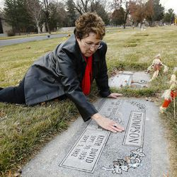 Wilda Thompson visits the grave of her husband and son at the Murray Cemetery in Murray Nov 19, 2014. Several Thompson family members have died of cancer.