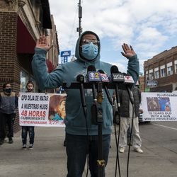 Baltazar Enriquez holds his hands up while speaking to reporters, after the body camera footage of Chicago police killing Adam Toledo was released, Thursday, April 15, 2021 in Chicago. A 13-year-old Chicago boy appears to have dropped a handgun and begun raising his hands less than a second before a police officer shot and killed him last month, footage released Thursday under community pressure shows.