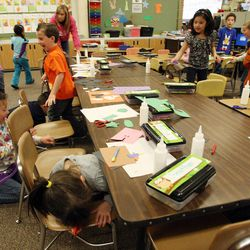 Vista Elementary kindergarten students in Danielle Wilson's class crawl under their desks as they participate in an earthquake drill in Taylorsville, Tuesday, April 17, 2012. This was part of the Great Utah ShakeOut.