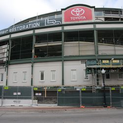 11:03 a.m. The view on the Addison Street side of the marquee. Note the Toyota banner, at the top of the ballpark. Also the telescoping work platform, on the right -