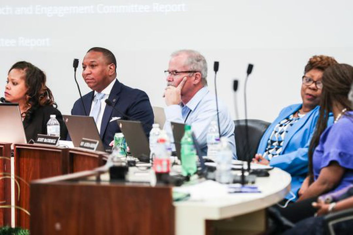 The Shelby County Schools board hired Joris Ray, second from left, as superintendent Tuesday.