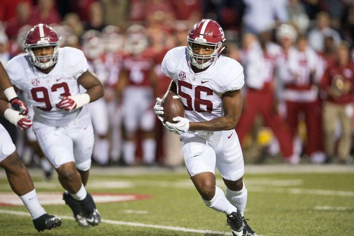 Oct 8, 2016; Fayetteville, AR, USA; Alabama Crimson Tide linebacker Tim Williams (56) returns a fumble by Arkansas Razorbacks quarterback Austin Allen (not pictured) for a touchdown as defensive lineman Jonathan Allen (93) trails the play during the secon