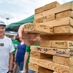 SOUTH BEND, IN - SEPTEMBER 01: Notre Dame Fighting Irish fans partake in tailgate party mode playing a game of Jumbo Jenga prior to game action during the NCAA football game between the Michigan Wolverines and the Notre Dame Fighting Irish on September 1, 2018 at Notre Dame Stadium, in South Bend, Indiana. The Notre Dame Fighting Irish defeated the Michigan Wolverines by the score of 24-17.