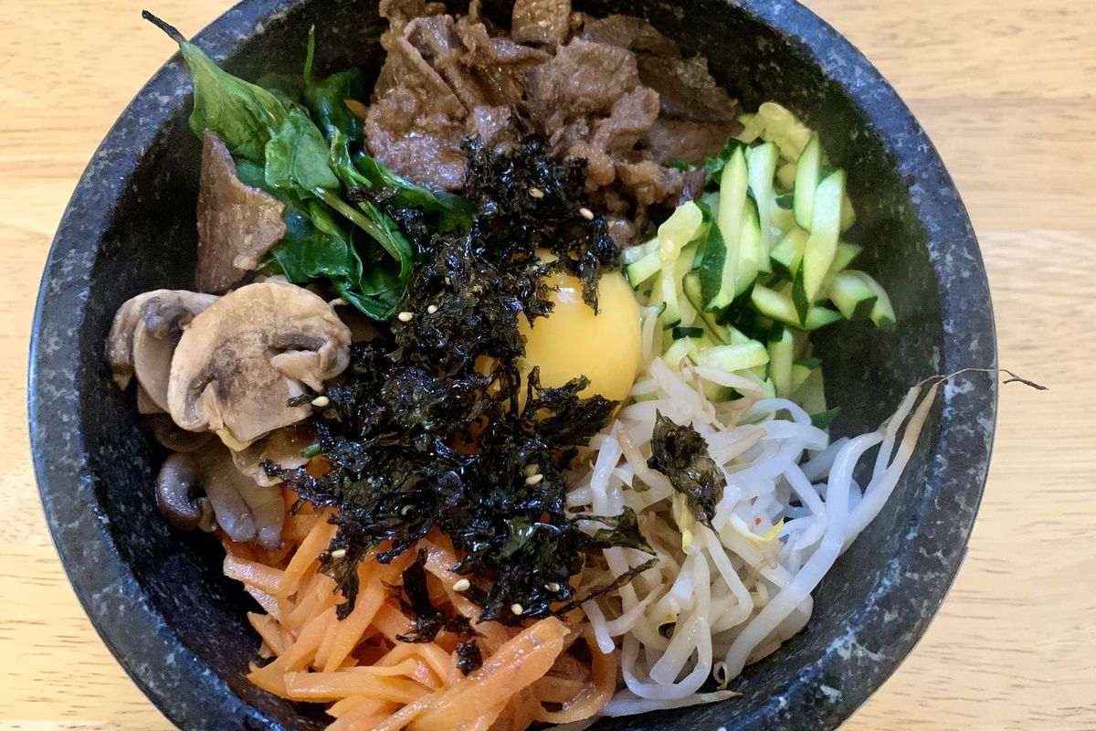 Bibimbap with carrot, pickles, and egg yolk