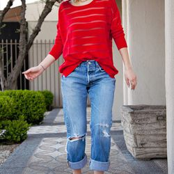 """Karla of <a href=""""http://www.karlascloset.com/2013/03/flaming-red.html"""">Karla's Closet</a> is wearing vintage Levi's 501s, a <a href=""""http://www.stylemint.com/shirts/sinclair-sweater/"""">StyleMint</a> Sinclair sweater and a <a href=""""http://www.jewelmint.com"""