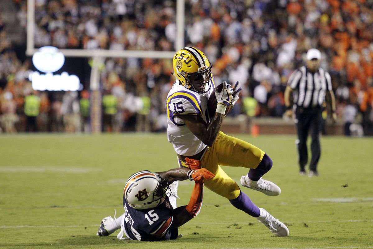LSU receiver Malachi Dupree is tackled by Auburn Tigers defensive back Joshua Holsey during the fourth quarter at Jordan Hare Stadium. The Auburn Tigers beat the LSU Tigers 18-13.