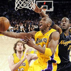 Los Angeles Lakers guard Kobe Bryant puts up a shot as Denver Nuggets center Johan Petro, right, guards while Lakers' Pau Gasol of Spain, looks on during the first half of their NBA basketball game, Thursday, April 9, 2009, in Los Angeles.