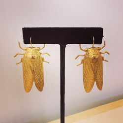 """Only <a href=""""http://ericaweiner.com/""""target=""""_blank"""">Erica Weiner</a> could make Cicadas look chic. (Buy them for an easy $30 <a href=""""http://ericaweiner.com/collections/earrings/products/cicada-earrings#.Ul1TamTk_R0""""target=""""_blank"""">here</a>!)"""