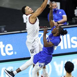 Gonzaga Bulldogs guard Jalen Suggs (1) blocks Brigham Young Cougars guard Brandon Averette (4) as BYU and Gonzaga play in the finals of the West Coast Conference tournament at the Orleans Arena in Las Vegas on Tuesday, March 9, 2021. Gonzaga won 88-78.