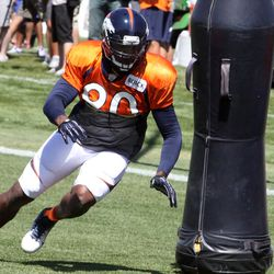 Denver Broncos off-season addition Shaun Phillips makes hit way around the pad during the sixth day of training camp