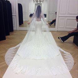 Givenchy's Riccardo Tisci custom-made the lavish dress for Kim Kardashian's May 24th, 2014 wedding to Kanye West.