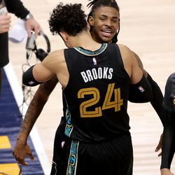 Memphis Grizzlies guard Ja Morant (12) and Memphis Grizzlies forward Dillon Brooks (24) celebrate as they defeat the Utah Jazz in game one of their NBA playoff series at Vivint Arena in Salt Lake City on Sunday, May 23, 2021. Memphis won 112-109.