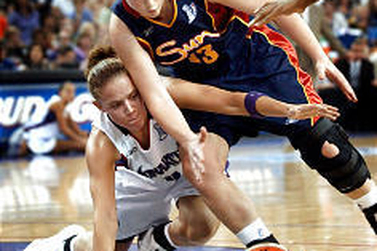Sacramento's Kristen Haynie, left, goes for a steal against Connecticut's Lindsay Whalen. The Monarchs secured its first-ever WNBA title.