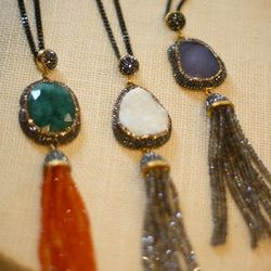 <bold>Transformation Tassel necklace</bold>: crystal-encrusted sapphire druzy quartz (right), labradorite tassel, $365