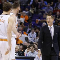 Phoenix Suns head coach Jeff Hornacek smiles at Goran Dragic (1), of Slovenia, and Miles Plumlee during the second half in an NBA basketball game against the Portland Trail Blazers, Wednesday, Oct. 30, 2013, in Phoenix.  The Suns defeated the Trail Blazers 104-91. (AP Photo/Ross D. Franklin)