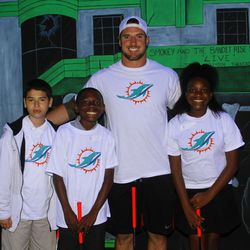 Austin Spitler with students from Henry S. Reeves Elementary at Monster Mini Golf in Miramar