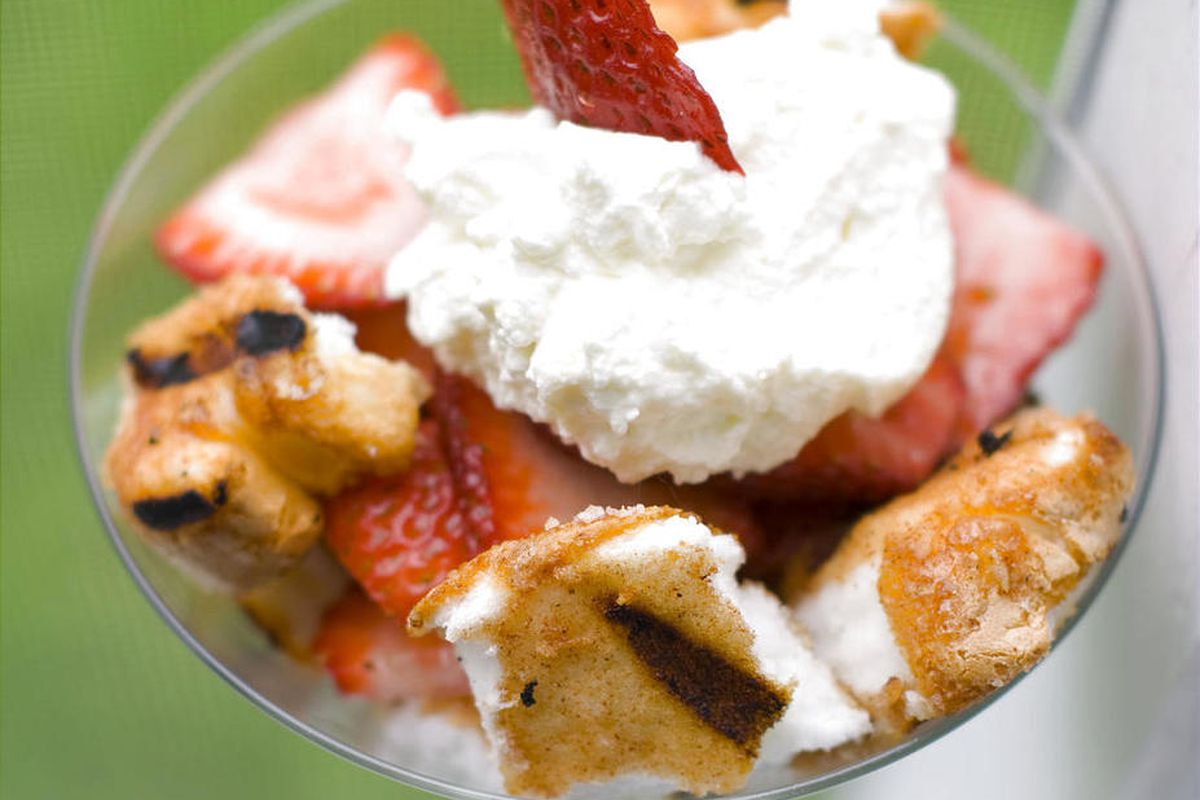 This May 30, 2012 image shows a dessert of spiced and grilled angel food cake with strawberries and whipped cream in Concord, N.H. Now people are whipping more than just cream, they're whipping all their favorite drinks.