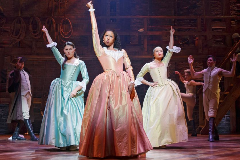 "Phillipa Soo, Renée Elise Goldsberry, and Jasmine Cephas Jones as Eliza, Angelica, and Peggy Schuyler onstage in ""Hamilton."""