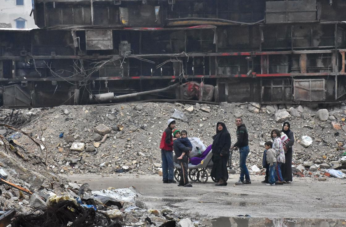 Residents of Aleppo amid the rubble