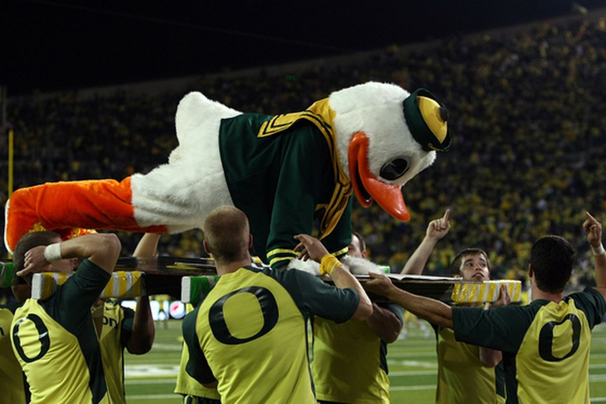 EUGENE OR - OCTOBER 21:  The Oregon Duck mascot does push ups after a touchdown against the UCLA Bruins  on October 21 2010 at the Autzen Stadium in Eugene Oregon.  (Photo by Jonathan Ferrey/Getty Images)