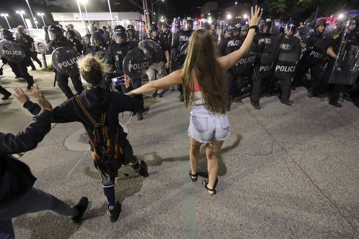 Police push back protesters as they violate curfew to protest the death of George Floyd in Salt Lake City on May 30, 2020.