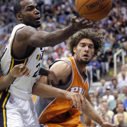 Utah Jazz forward Paul Millsap (24) tries to maintain control of the ball under the hoop with Phoenix Suns center Robin Lopez (15) defending as the Utah Jazz and the Phoenix Suns play Tuesday, April 24, 2012 in Energy Solutions arena.