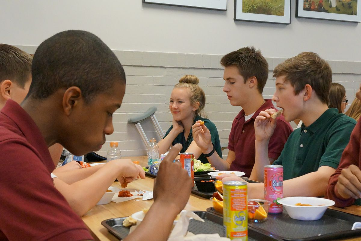 Students eat lunch at the Oaks Academy Middle School, a private Christian school in Indiana that accepts taxpayer funded vouchers. All students at the private school must take Indiana's state tests. Whether Tennessee should have a similar requirement in its voucher proposal is up for debate.