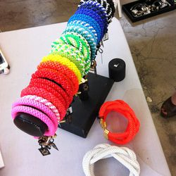 Noir's double shaka bracelets remind us of the lanyard bracelets we used to make at summer camp.